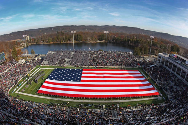 giant american flag at west point during halftime