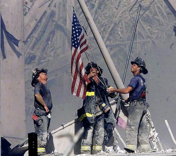 american flag at ground zero after the twin tower terroroist attacks
