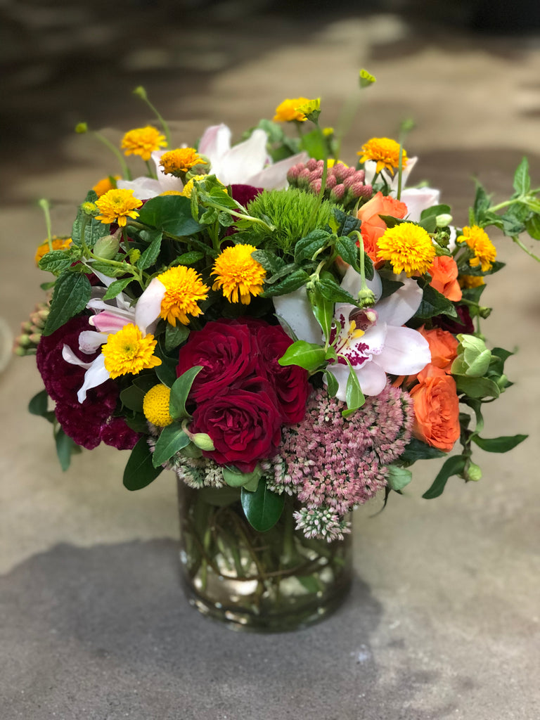 Beautiful fall arrangement of orchids and roses
