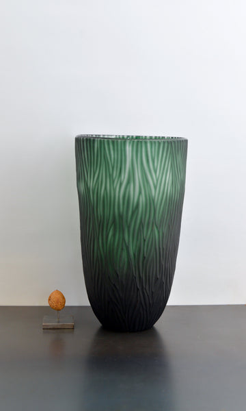 Green cut glass vase textured