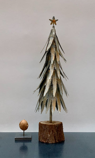 Metal Christmas tree on wooden stand