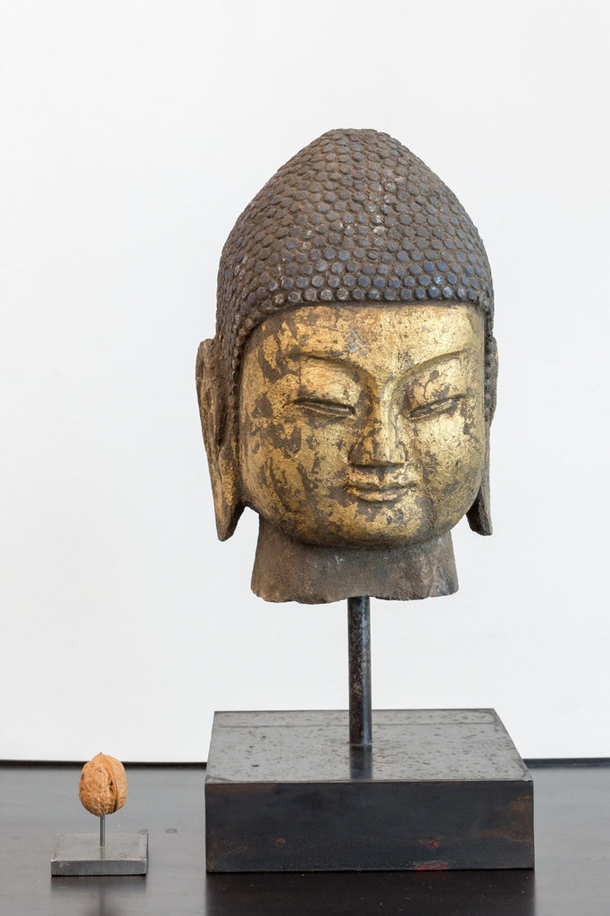 buddha head sculpture gold leaf