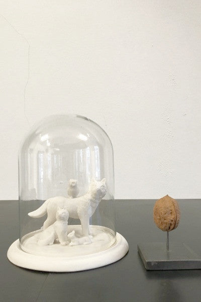 Glass dome filled with porcelain wolf, owl, fox and squirrel