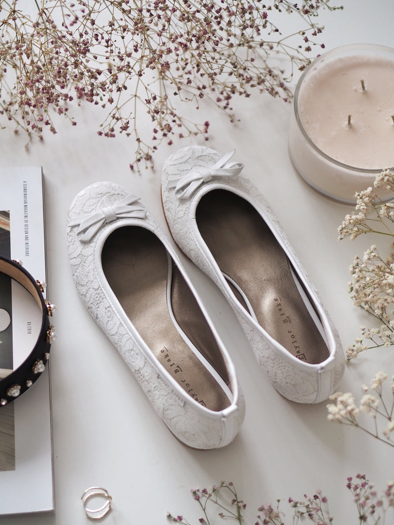 White lace ballerina pumps by Taylor Blake