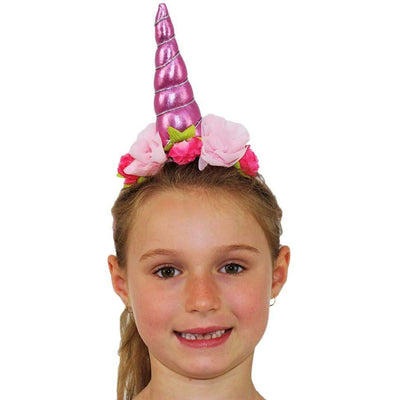Girl wearing pink unicorn headband