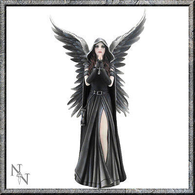 A dark angel, standing, wings outstretched, hands held in prayer