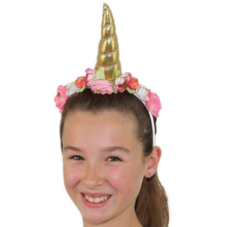 Girl wearing gold unicorn head band