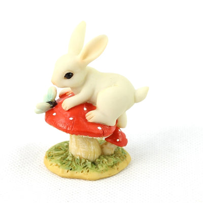 Tiny bunny on a toadstool figure