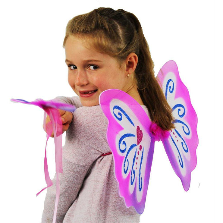 Girl demonstrating pink pixie wings and wand