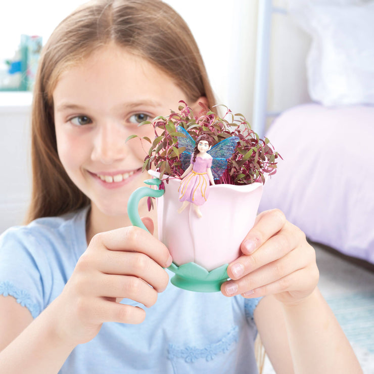 Girl holding the teacup fairy garden