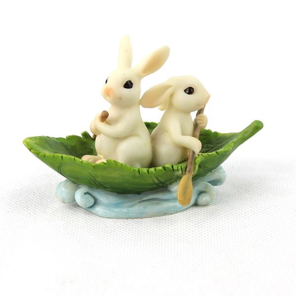 Tiny bunnies in a leaf boat, fairy garden figure