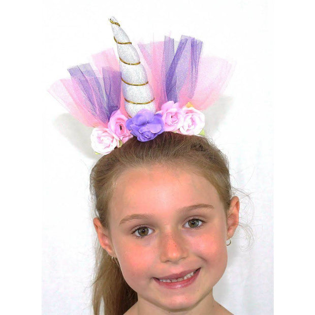 Girl wearing silver unicorn headband