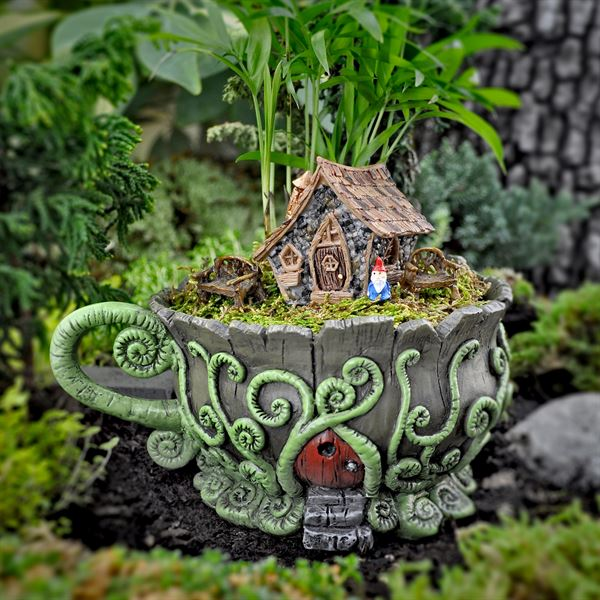 Woodland fiddlehead teacup planter in use