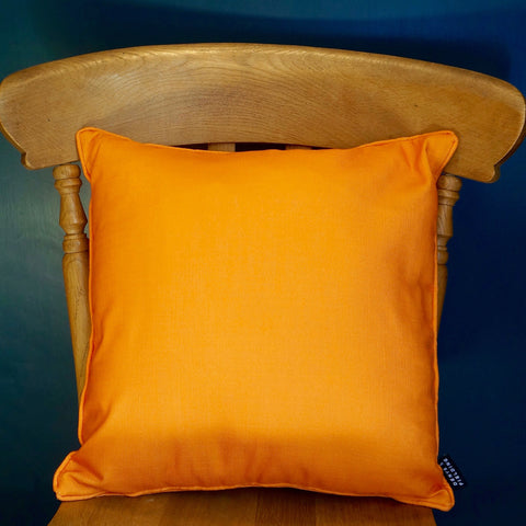 marigold orange cushion from Denys & Fielding