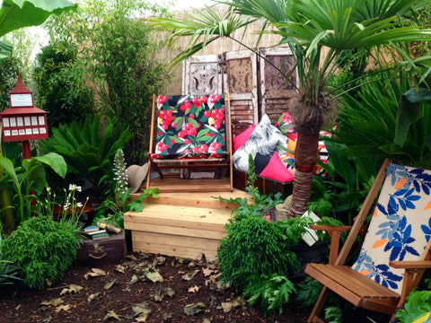 Deckchairs and cushions in a jungly garden