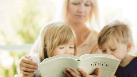 Mother reads bible to her children