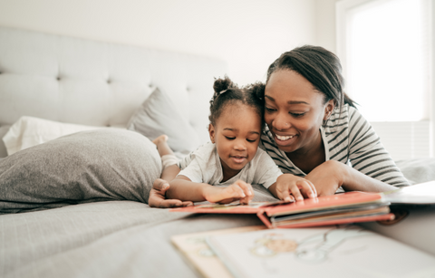 mom and child reading book together