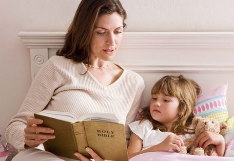 mom and child reading bible together