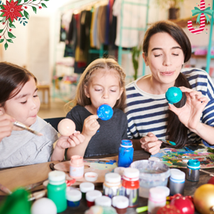 Mom and kids decorating Christmas ornaments