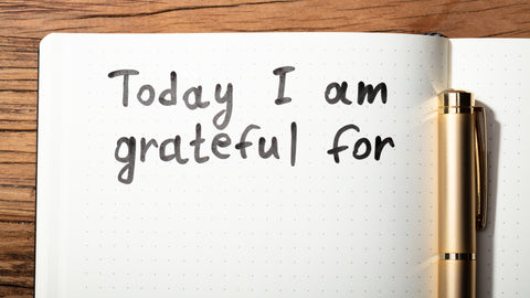 Notebook with a page titled - Today I am grateful for ...