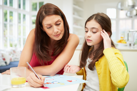 Mom assisting middle school aged daughter with homework