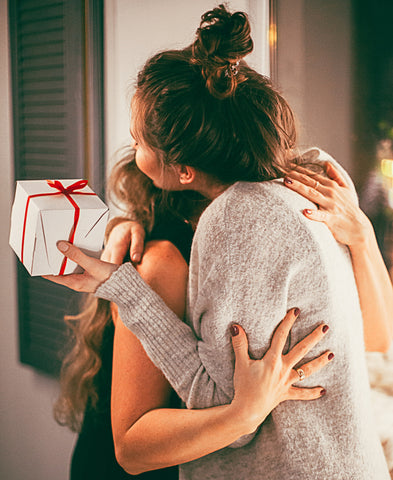 Two woman hugging
