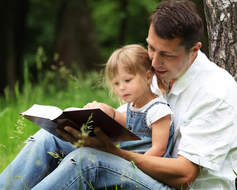 dad and daughter reading bible
