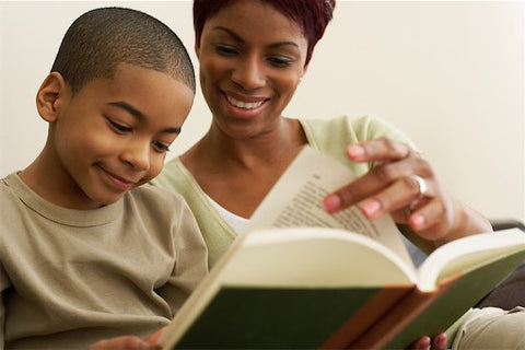 mom and son reading bible together