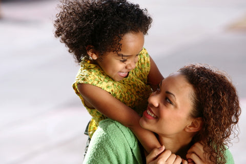 black woman and child smiling