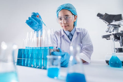 Image of female scientist doing an experiment in a lab
