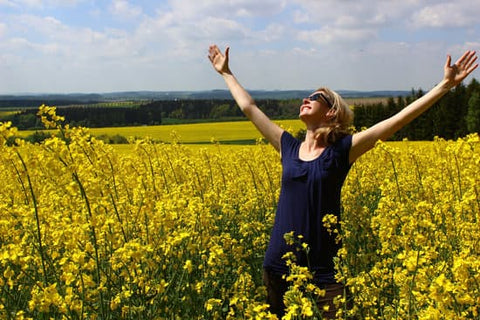 a lady rejoicing in fields
