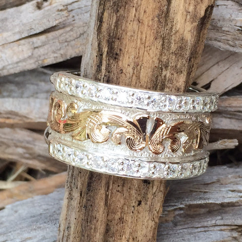Q. Narrow Band Gold & Silver ring