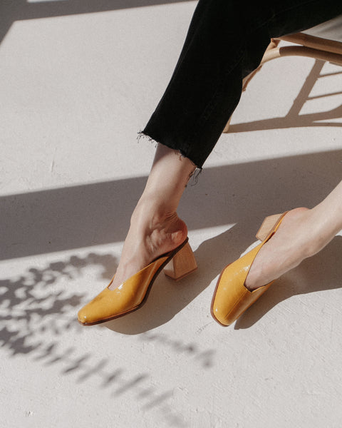 Paloma Wool Garapago Mules in Burnt Yellow