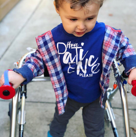 special needs toddler walking with adaptive equipment; eazyhold and a gait trainer