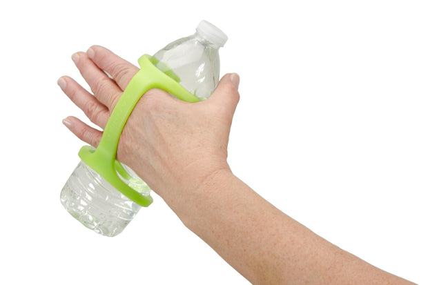 A water bottle adapted by a green eazyhold sippy cup holder for ADLs