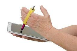 Hands using a yellow assistive deviceto write with a stylus on a tablet.