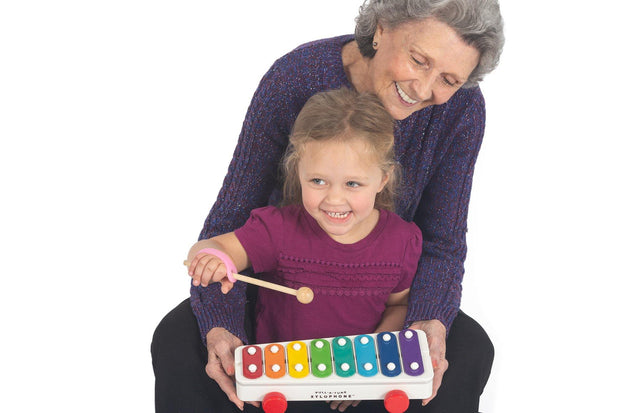 Mom with special needs child playing an instrument with and adaptive aid