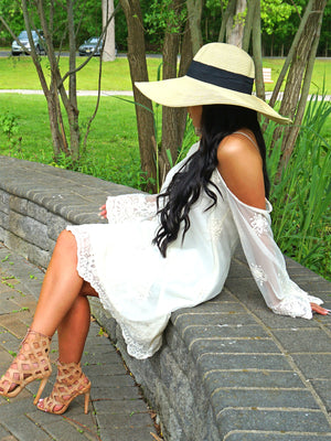 Tan Wide Brimmed Floppy Hat With Black Ribbon Hat Band