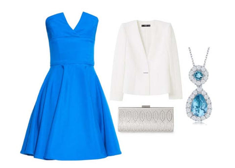 Blue dress, white blazer, silver clutch, and blue topaz pendant necklace