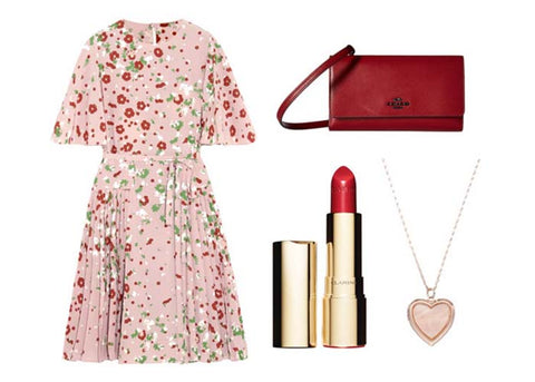 Pink dress with red florals, red clutch, red lipstick, pink heart necklace