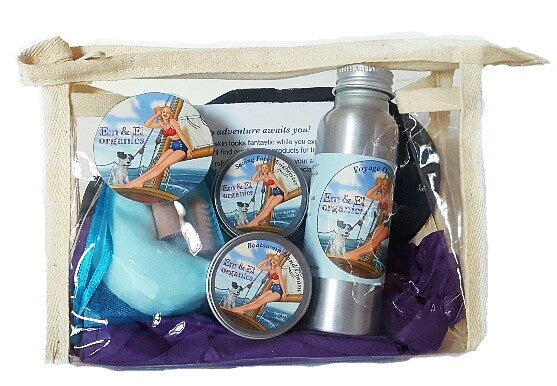 Travel skin care set with facial toner, face moisturizer, hand cream, sleep mask, earplugs in a clear plastic travel bag