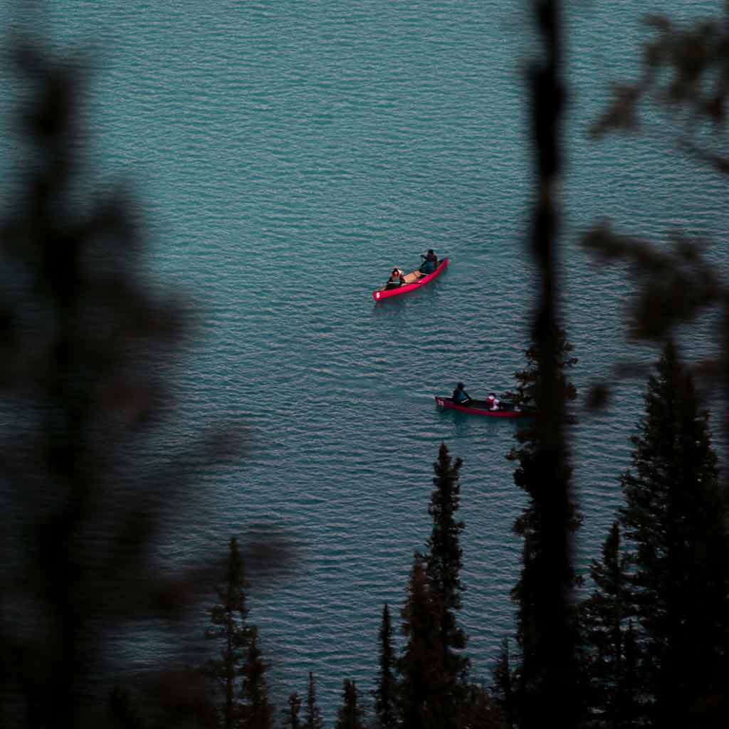 People canoeing on lake