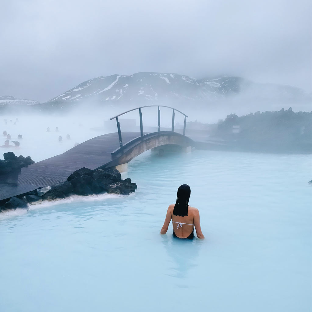 Woman swimming in the blue lagoon in Iceland