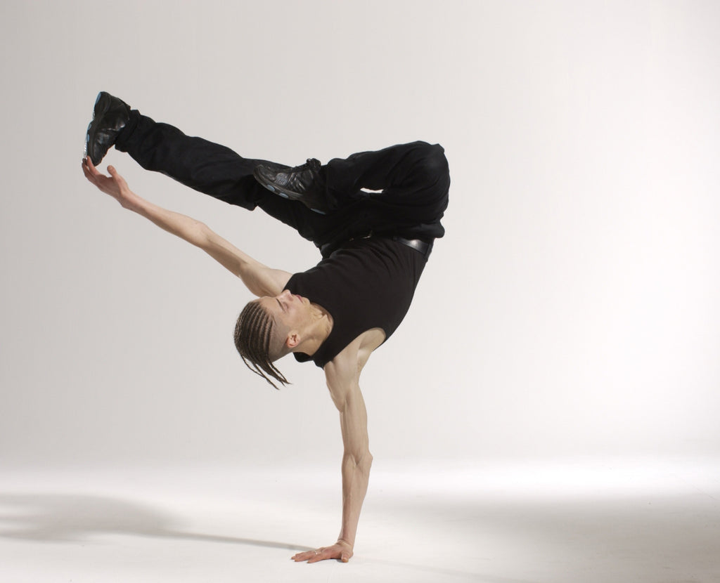 Man does yoga pose in studio