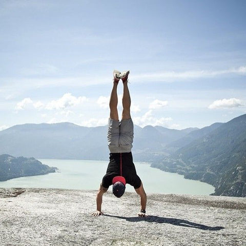 Yoga handstand on mountain with Strongbody