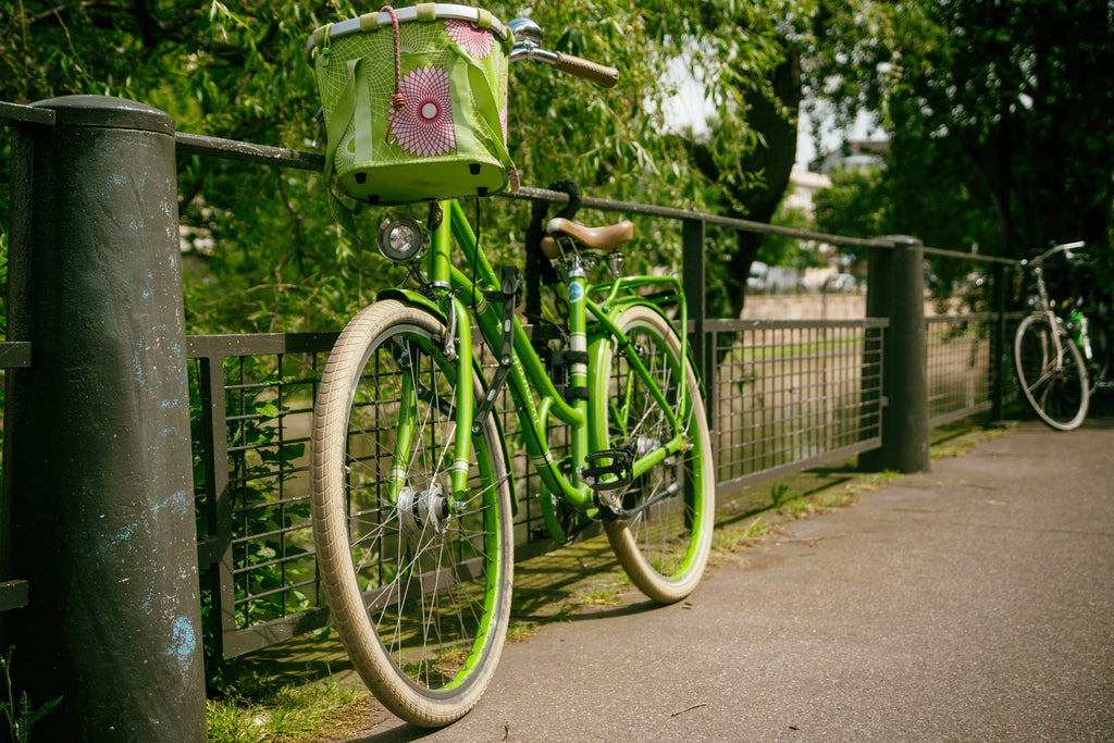 riding a green bike in your small community