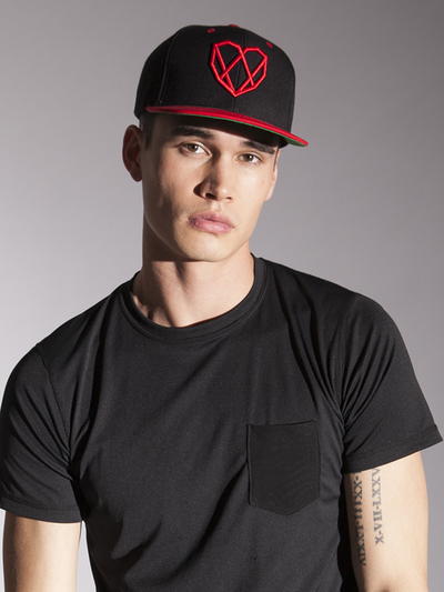 A Black Snapback Hat with a Red Strongbody Logo on the front