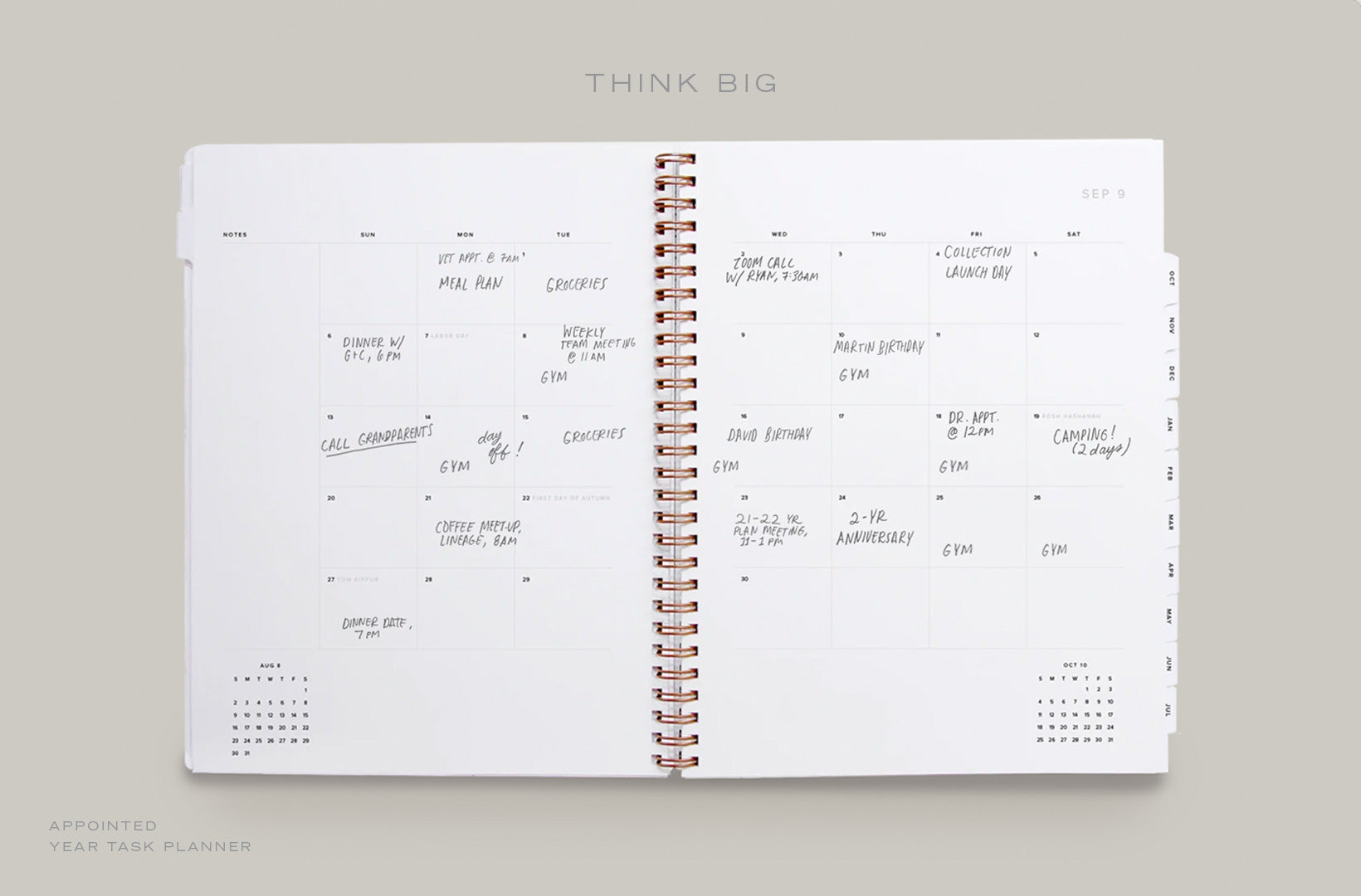 A Year Task Planner lays open to the month spread with appointments and events filled in
