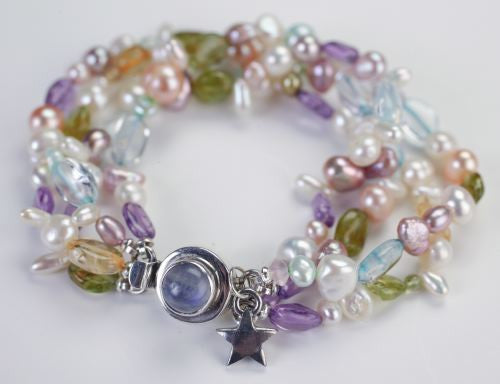 Bracelet of different kinds of semi precious stone and a freshwater pearl
