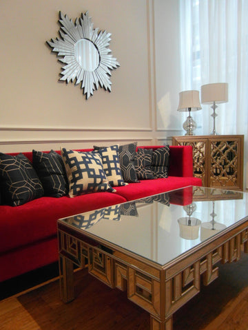Windsor Sofa.  Red Sofa. Machurian Gates Handcarved Coffee Table.  Glorious Sun Mirror. Candice Olsen Cushions. Iberian Morrocan Cabinet.